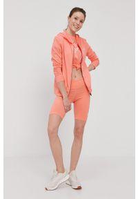 Reebok - Szorty. Kolor: pomarańczowy. Materiał: dzianina, skóra. Wzór: nadruk