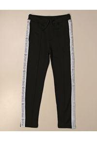 DSQUARED2 KIDS - Czarne spodnie dresowe z lampasami 4-16 lat. Kolor: czarny. Materiał: dresówka. Wzór: nadruk. Sezon: lato. Styl: sportowy