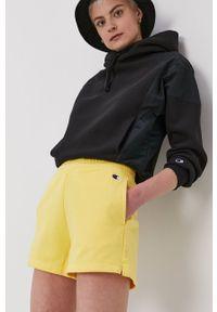Champion - Szorty. Okazja: na co dzień. Kolor: żółty. Materiał: dzianina. Wzór: gładki. Styl: casual