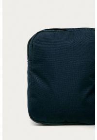 New Balance - Saszetka. Kolor: niebieski. Rodzaj torebki: na ramię