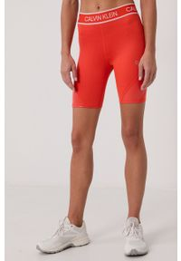 Calvin Klein Performance - Szorty. Stan: podwyższony. Kolor: pomarańczowy. Wzór: nadruk