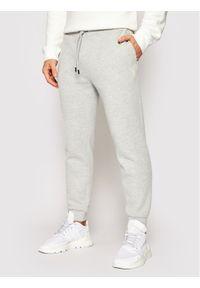 Guess Spodnie dresowe U1YA04 K9V31 Szary Regular Fit. Kolor: szary. Materiał: dresówka