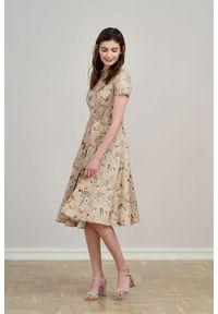 Marie Zélie - Sukienka Alana Beżowa kwiecista. Typ kołnierza: kokarda. Kolor: beżowy. Materiał: bawełna, skóra, materiał, elastan. Styl: wizytowy, elegancki