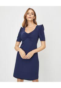 Kenzo - KENZO - Granatowa sukienka mini. Kolor: niebieski. Materiał: materiał. Typ sukienki: kopertowe. Styl: klasyczny, militarny. Długość: mini