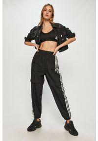 adidas Originals - Spodnie. Kolor: czarny. Materiał: włókno, tkanina, materiał