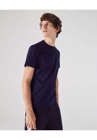 Lacoste - LACOSTE - Granatowy t-shirt z okrągłym dekoltem. Okazja: na co dzień. Kolor: niebieski. Materiał: jeans, bawełna. Styl: casual, klasyczny