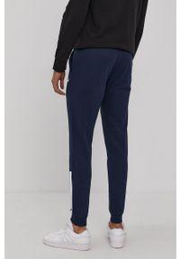Diadora - Spodnie. Okazja: na co dzień. Kolor: niebieski. Materiał: dzianina, bawełna. Wzór: nadruk. Styl: casual