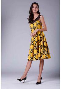Nommo - Rozkloszowana Sukienka Midi z Prześwitującym Karczkiem. Materiał: wiskoza, poliester. Długość: midi