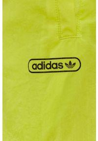 Żółte spodnie dresowe adidas Originals gładkie