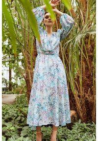 Lemoniade - Kopertowa sukienka midi z jedwabiem. Okazja: na co dzień. Typ kołnierza: dekolt w kształcie V. Materiał: jedwab. Typ sukienki: kopertowe. Styl: casual. Długość: midi