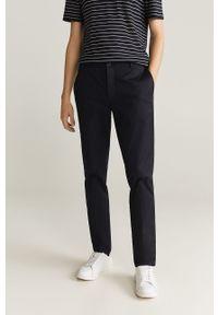 Mango Man - Spodnie Dublin. Kolor: czarny. Materiał: tkanina. Wzór: gładki