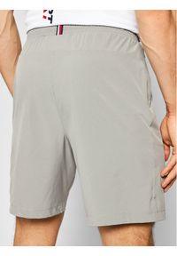 TOMMY HILFIGER - Tommy Hilfiger Szorty sportowe Logo Training MW0MW17257 Szary Regular Fit. Kolor: szary