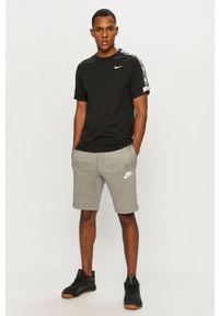 Czarny t-shirt Nike Sportswear na co dzień, casualowy, z aplikacjami