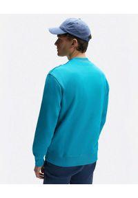 North Sails - NORTH SAILS - Niebieska bluza oversize z logo. Kolor: niebieski. Materiał: bawełna. Długość rękawa: długi rękaw. Długość: długie. Wzór: nadruk, aplikacja, kolorowy