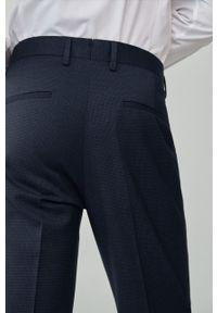 Niebieskie spodnie Mango Man gładkie