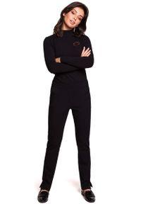 MOE - Czarne Dzianinowe Spodnie na Gumie z Rozciętymi Nogawkami. Kolor: czarny. Materiał: dzianina, guma