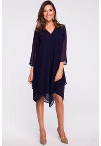 e-margeritka - Sukienka szyfonowa elegancka granatowa - l. Okazja: na wesele, na ślub cywilny, na imprezę, na co dzień. Kolor: niebieski. Materiał: szyfon. Typ sukienki: proste, asymetryczne, trapezowe. Styl: elegancki. Długość: midi
