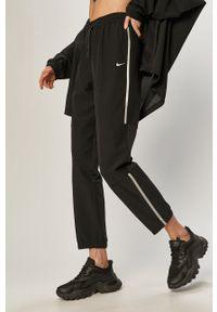 Nike - Spodnie. Kolor: czarny