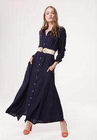 Born2be - Granatowa Sukienka Controllable. Okazja: na co dzień. Kolor: niebieski. Długość rękawa: długi rękaw. Typ sukienki: rozkloszowane, szmizjerki. Styl: klasyczny, casual. Długość: maxi