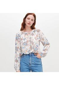Kremowa bluzka Reserved w kwiaty