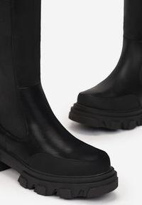 Renee - Czarne Kozaki Bemien. Wysokość cholewki: przed kolano. Nosek buta: okrągły. Zapięcie: zamek. Kolor: czarny. Materiał: guma. Szerokość cholewki: normalna. Obcas: na obcasie. Wysokość obcasa: średni