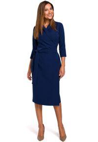 e-margeritka - Sukienka kopertowa midi granatowa - l. Okazja: do pracy. Kolor: niebieski. Materiał: tkanina, poliester, materiał, elastan. Typ sukienki: kopertowe. Styl: elegancki. Długość: midi