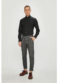 Tommy Hilfiger Tailored - Koszula. Typ kołnierza: kołnierzyk włoski. Kolor: czarny. Materiał: tkanina. Wzór: gładki