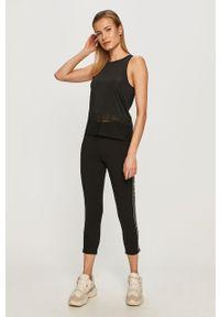 Czarne legginsy DKNY z aplikacjami