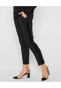 MARLU - Czarne spodnie z lampasami. Okazja: na co dzień. Kolor: czarny. Materiał: welur, bawełna. Wzór: gładki. Styl: elegancki, casual