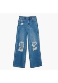 Cropp - Jeansy wide leg z rozdarciami - Niebieski. Kolor: niebieski