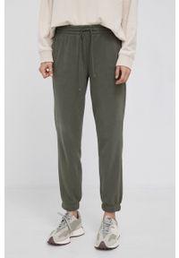 Drykorn - Spodnie Once. Kolor: zielony. Materiał: dzianina. Wzór: gładki