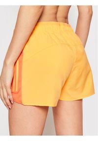 Pomarańczowe spodenki sportowe Adidas do biegania