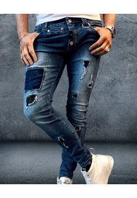 GUNS & TUXEDOS - Niebieskie jeansy z dziurami Furious. Kolor: niebieski. Styl: elegancki
