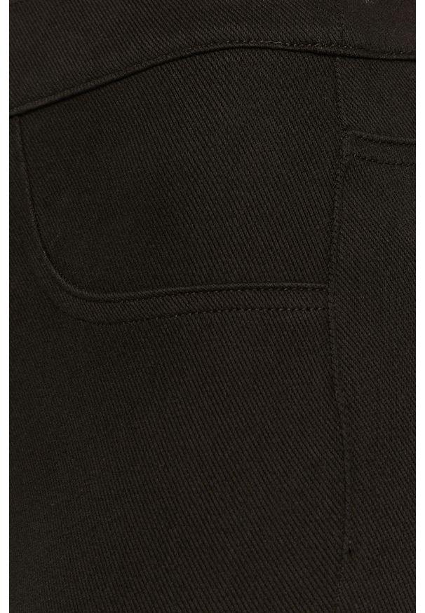 Czarne legginsy sportowe Spanx