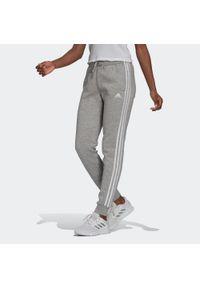 Adidas - Spodnie dresowe damskie. Materiał: bawełna, wiskoza, poliester