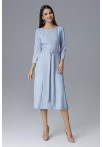 e-margeritka - Klasyczna sukienka midi wiązana w talii błękit - m. Okazja: do pracy, na spotkanie biznesowe. Materiał: poliester, materiał. Typ sukienki: proste. Styl: klasyczny. Długość: midi
