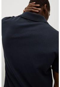 Mango Man - Polo Rea. Okazja: na co dzień. Typ kołnierza: polo. Kolor: niebieski. Materiał: skóra, materiał. Długość: krótkie. Styl: casual