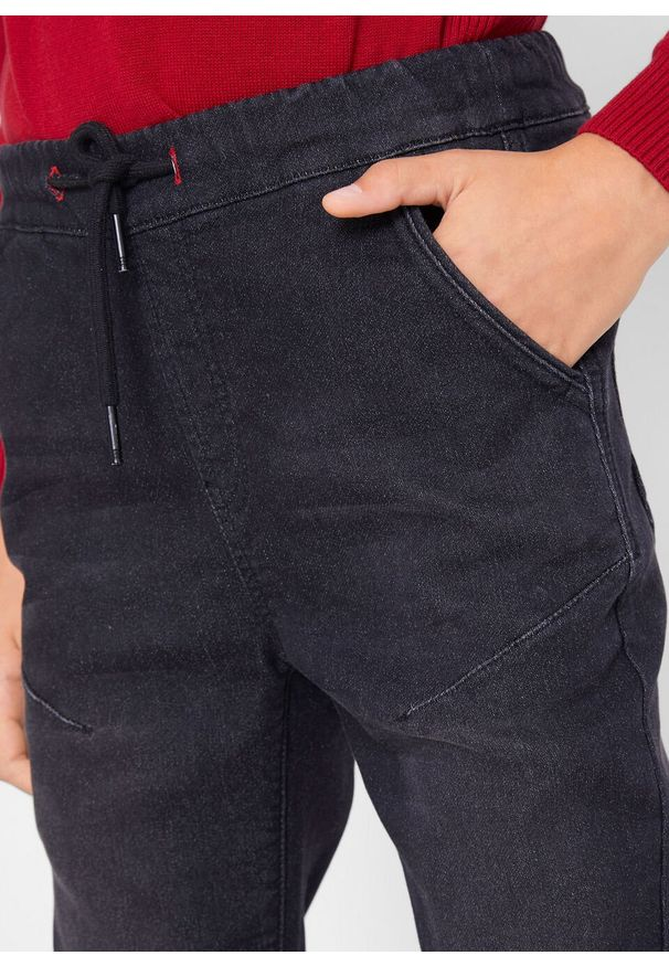 Czarne jeansy bonprix na zimę
