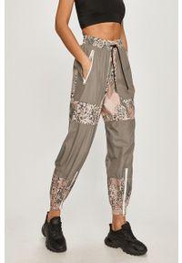 Adidas by Stella McCartney - adidas by Stella McCartney - Spodnie. Kolor: szary. Materiał: tkanina