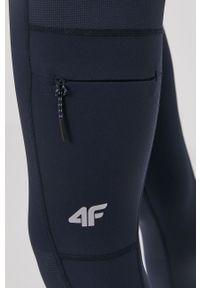 4f - 4F - Legginsy. Stan: podwyższony. Kolor: niebieski. Materiał: włókno, materiał