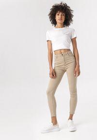 Beżowe spodnie skinny Born2be