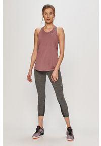 Nike - Legginsy. Kolor: szary. Materiał: tkanina, dzianina, skóra, włókno. Technologia: Dri-Fit (Nike). Wzór: gładki