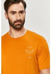 Scotch & Soda - T-shirt. Okazja: na co dzień. Kolor: pomarańczowy. Materiał: bawełna. Wzór: nadruk. Styl: casual