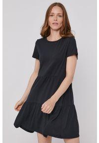 GAP - Sukienka. Okazja: na co dzień. Kolor: czarny. Materiał: dzianina. Długość rękawa: krótki rękaw. Wzór: gładki. Typ sukienki: proste. Styl: casual