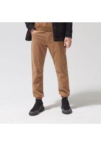 Beżowe spodnie Cropp