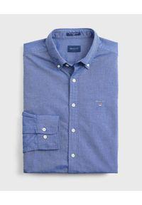 GANT - Niebieska koszula z bawełny. Kolor: niebieski. Materiał: bawełna. Długość rękawa: długi rękaw. Długość: długie. Wzór: haft. Styl: klasyczny