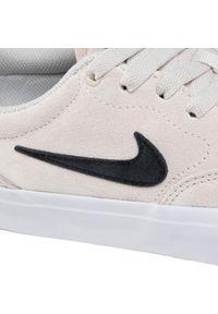 Beżowe buty sportowe Nike z cholewką