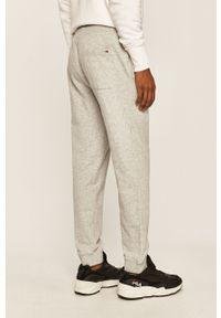 Szare spodnie dresowe Tommy Jeans z nadrukiem