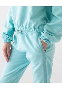 MARLU - Spodnie dresowe Jane. Kolor: niebieski. Materiał: dresówka