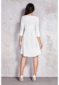 Infinite You - Elegancka asymetryczna rozkloszowana sukienka. Materiał: materiał, elastan. Typ sukienki: asymetryczne. Styl: elegancki